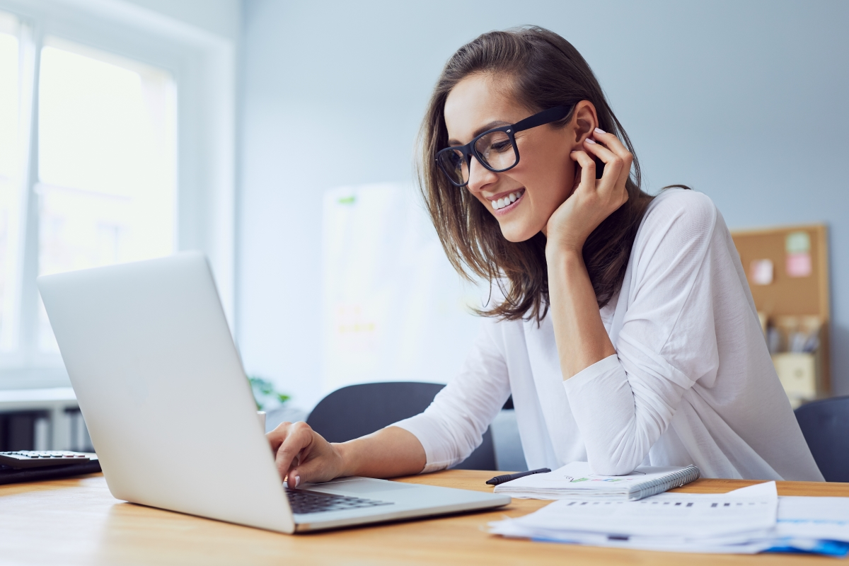 Women sitting at desk looking at computer for Search Intent Tips